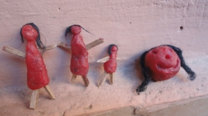Dolls made from the red wax wrapped around cheese