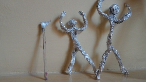 Aluminum foil figures and axe made from found materials